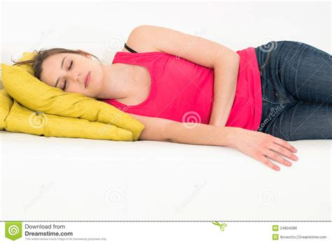sleeping in couch woman sleeping on a couch stock photo image of relaxed