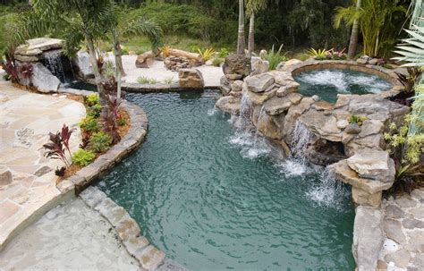backyard lagoon natural stone grotto waterfall with elevated spa lucas