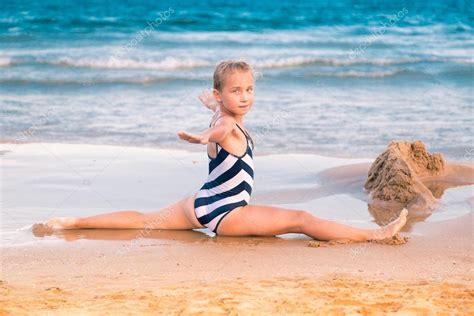 little girl models beach beautiful little girl excercising on the beach stock