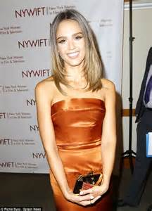 jessica alba is glamorous in orange satin frock at event