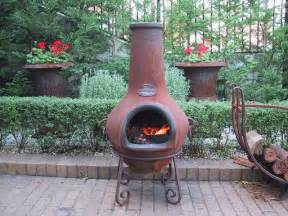 chiminea clay outdoor fireplace should you buy a pit chiminea or outdoor fireplace