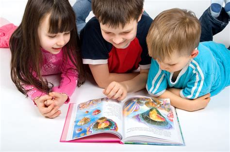 picture of a child reading a book pediaspeech reading to children
