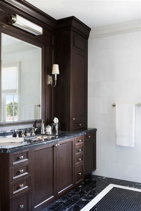 brown stained bath vanity with pink and black marble
