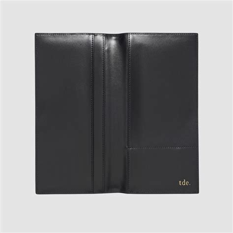 Black Wallet Dk Ft 01 black flat travel wallet monogram leather travel accessories the daily edited