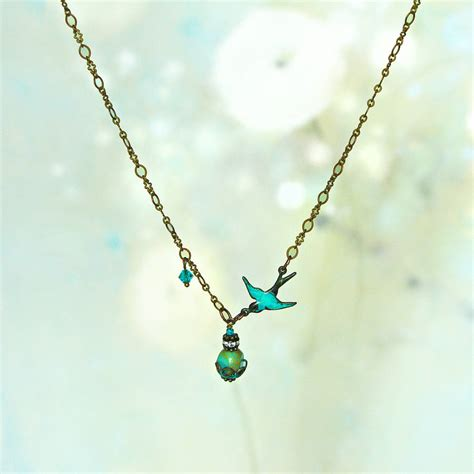 bird necklace with turquoise gemstone pendant by artique