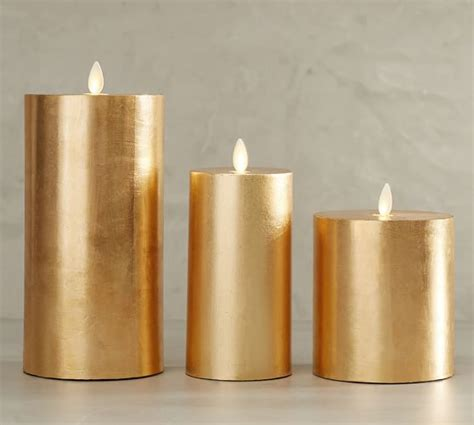 gold and cream pillar candles premium flicker flameless gilt pillar candle gold pottery barn