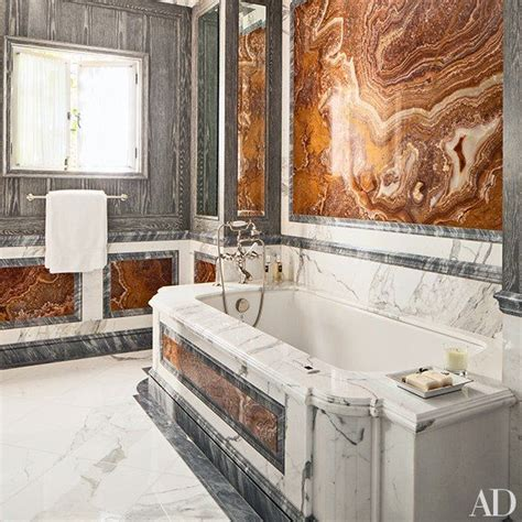 red marble bathroom a bath is paneled in distressed oak gray onyx and red