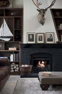 Black Painted Brick Fireplace by 50 Fireplace Makeovers For The Changing Seasons And Holidays