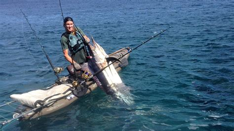 largest boat dealer in the world world record kayak caught black marlin hobie