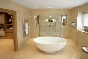 Bright beige tones warm this open bathroom surrounding a large oval