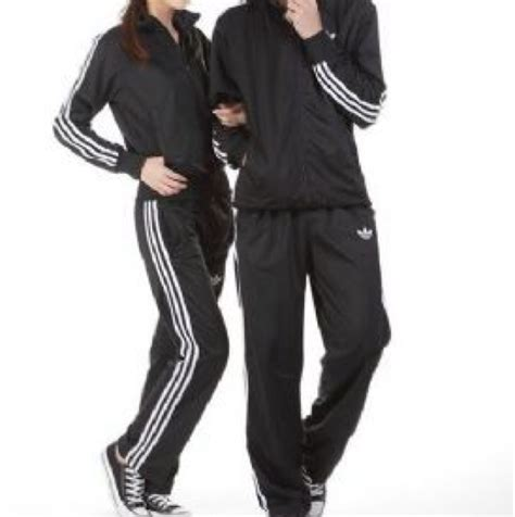 the blk actress in jogging suit in the liberty mutual commercial with a cup in hand adidas jogging suits for women