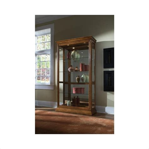 accent cabinets with sliding doors pulaski pulaski 2 way sliding door curio cabinet in golden
