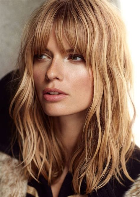 blunt med length cut with bangs top 10 most glamorous wavy hairstyles for shoulder length
