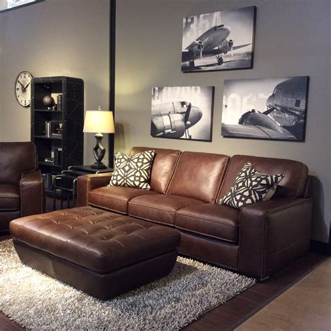 family room with warm gray walls black and white art