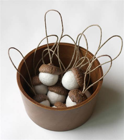 set of ten hand felted acorn decorations by rastall and