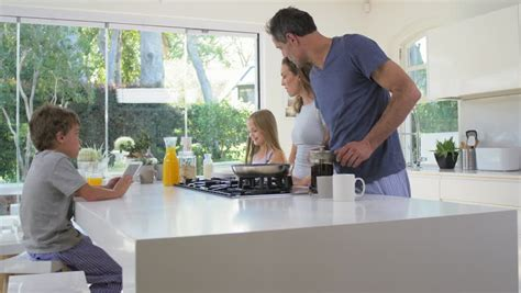 family in kitchen walks into family kitchen in modern