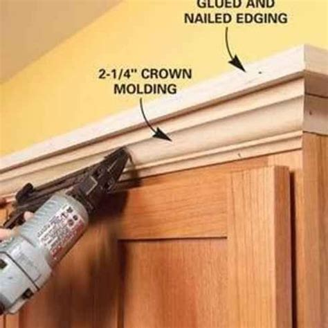molding for kitchen cabinets shelves above kitchen add molding shelving to the top of your kitchen cabinets