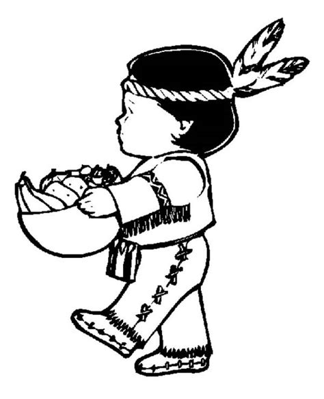 little indian boy holding corn bowl on thanksgiving day