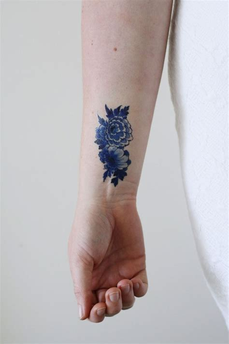 blue flower tattoo designs best 25 blue flower tattoos ideas on