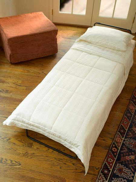 ottoman guest bed sleeper ottoman by day bed by night put your feet up and relax