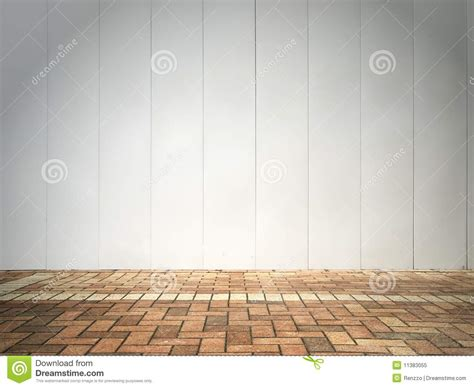 white wall with board and lights stock photo white wall and brick floor royalty free stock photo
