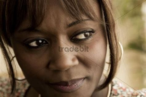 40 year old woman face dark skinned 40 year old woman face looking off to one