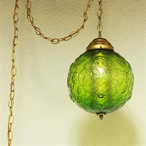 vintage style living room with in hanging l fixture and green glass globe lighting