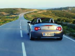 free wallpaper a blue sports car running on the road
