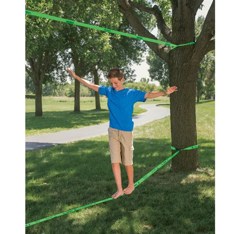 backyard tightrope the backyard slackline hammacher schlemmer
