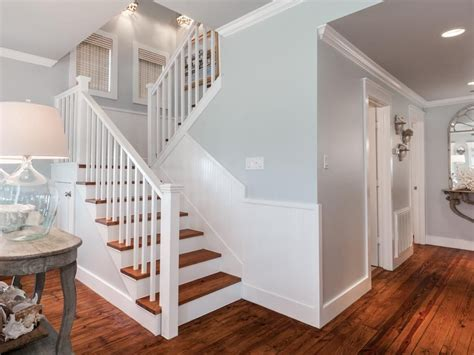 Cottage Staircase by Cottage Staircase With High Ceiling Hardwood Floors In
