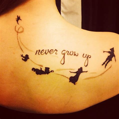 never grow up tattoo i m in with my new pan never grow up