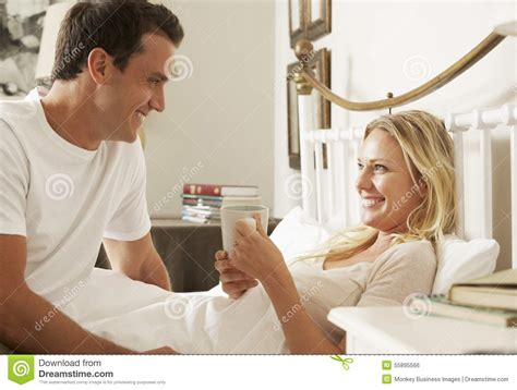 adults in bed hot husband bringing wife hot drink in bed at home stock photo image 55895566