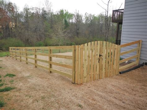 wood wire fence on wire fence fence and fencing chicken wire fence chicken wire netting and welded wire panels fixed to wooden frame