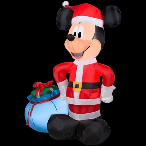 home depot inflatable christmas decorations gemmy 42 in h inflatable santa mickey with blue gift sack