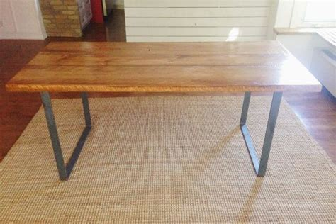 reclaimed wood dining table with 2 wrought iron legs