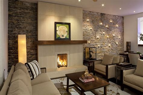 living room with accent wall stone wall fireplace living room mediterranean with accent