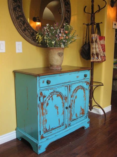 best primer for painting wood cabinets love this finish with distressed turquoise cabinet and