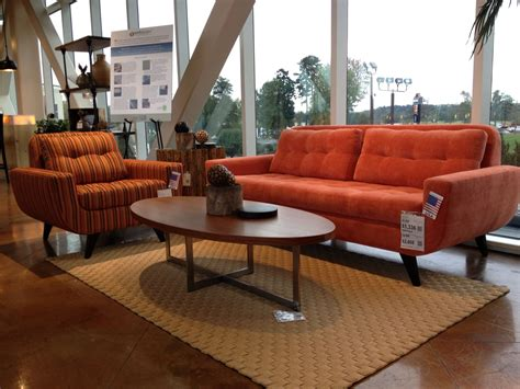 living room with orange sofa brown leather couches cozy living room with wooden oval