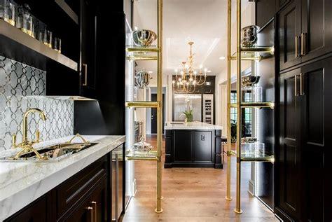 black  gold butler pantry  brass  glass shelves