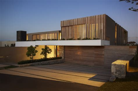 wooden facade modern house design by saota architecture