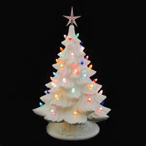 white ceramic christmas tree with glowing color lights 18