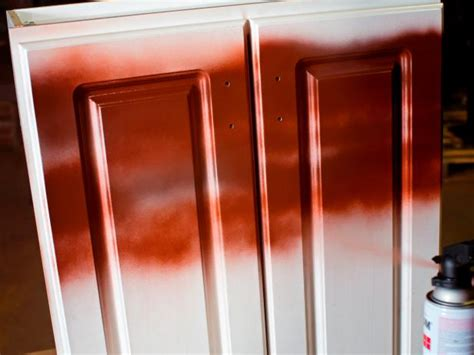 Spray Paint Kitchen Cabinets How To Paint Kitchen Cabinets With A Sprayed On Finish How Tos Diy