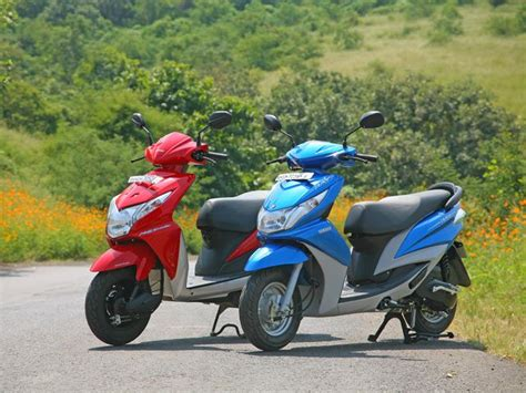yamaha ray vs honda dio new honda dio vs yamaha ray zigwheels first ride pics