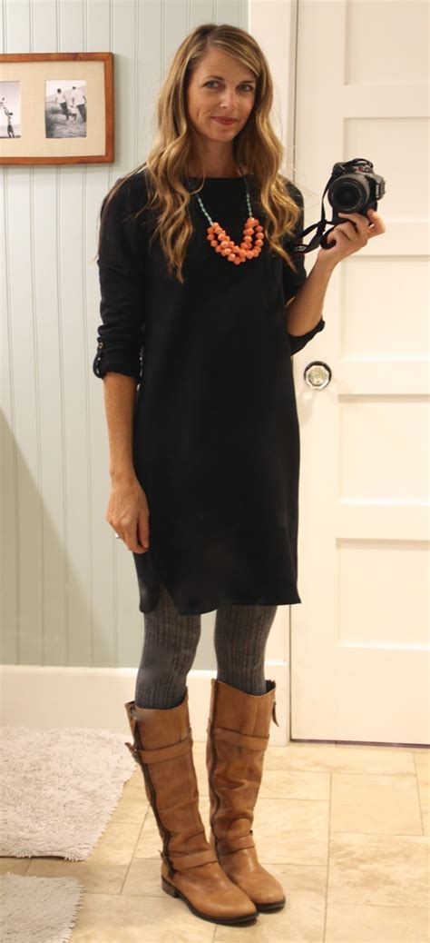 black shirt dress with gray sweater tights cognac boots