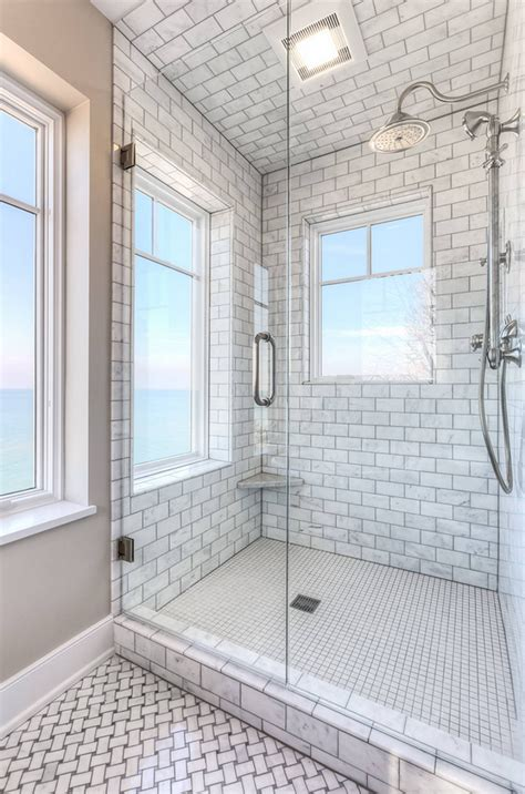 bathroom tile to ceiling shingle beachfront home with casual coastal interiors
