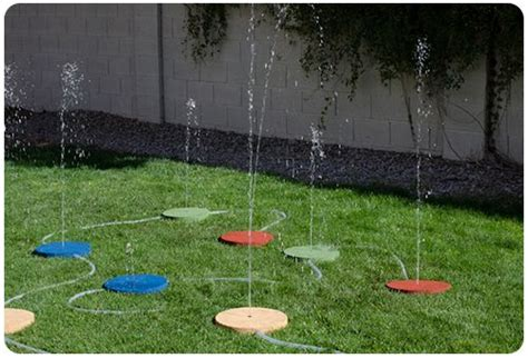 how to make a backyard splash pad splash pad ideas pinterest splash pad and diy and