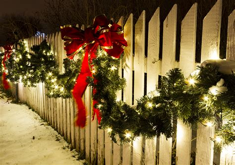 images of christmas garland on a fences decorating with wreaths garlands topline ie