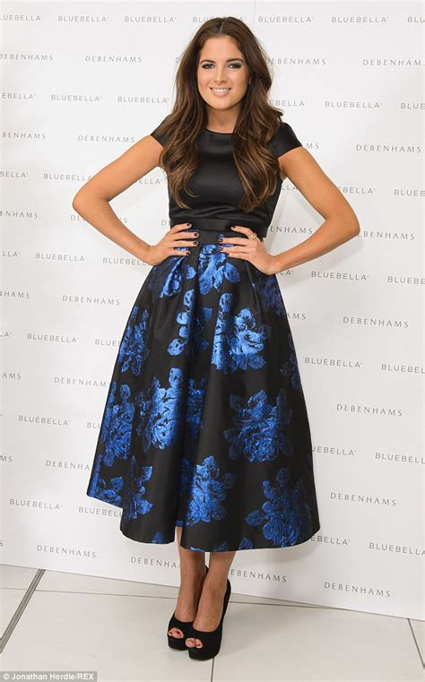 binky felstead covers up in demure floral skirt and satin