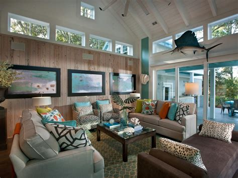 hgtv room coastal living room with neutral sofas and brown chaise telescoping glass doors open to the home