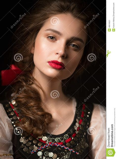 beautiful in russian beautiful russian in national dress with a braid hairstyle and stock